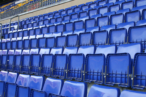 blue seats at the camp nou