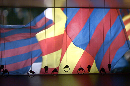 Headsets with FC Barcelona and Catalan flags in background