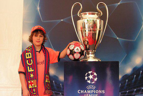 a customer with the Champions League trophy